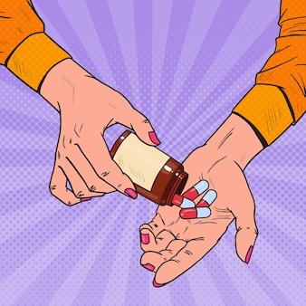 Mujer de arte pop sosteniendo una botella con medicamentos. manos femeninas con pastillas. suplemento farmacéutico.