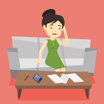 Mujer asiática infeliz que contabiliza las cuentas caseras.