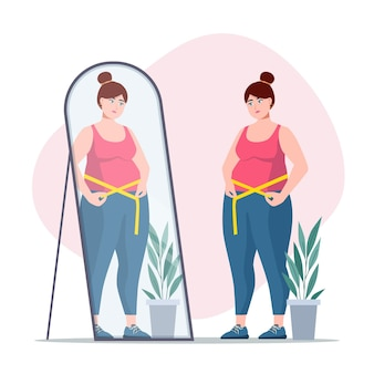 Mujer de baja autoestima mirando en el espejo