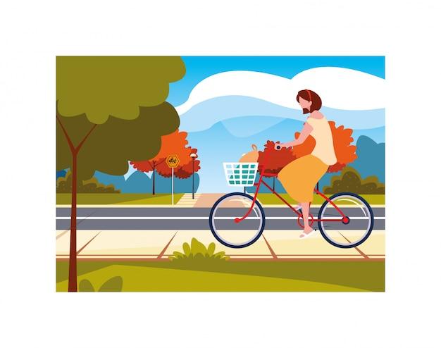 Mujer con bicicleta, mujer con estilo de vida saludable