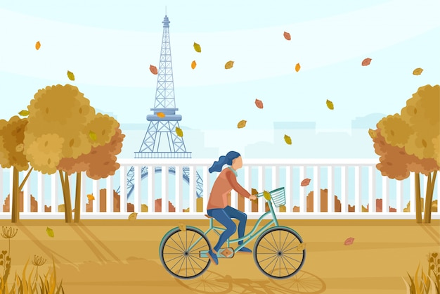 Mujer en bicicleta en parís