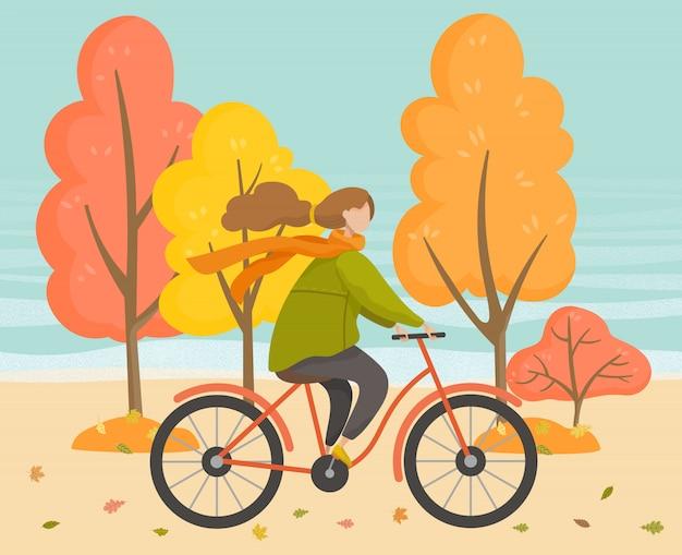 Mujer en bicicleta en el parque otoño, deporte