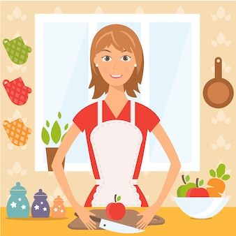 Mujer bonita en la cocina