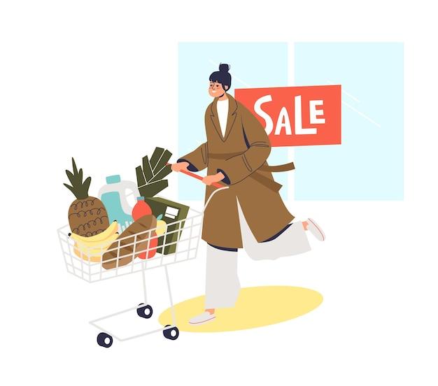 Mujer con carro completo después de la venta de compras en la tienda de comestibles.