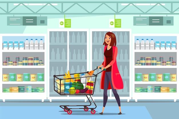 Mujer con carro en supermercado con carro lleno de comida sana