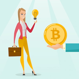Mujer caucásica recibiendo moneda de bitcoin para puesta en marcha.
