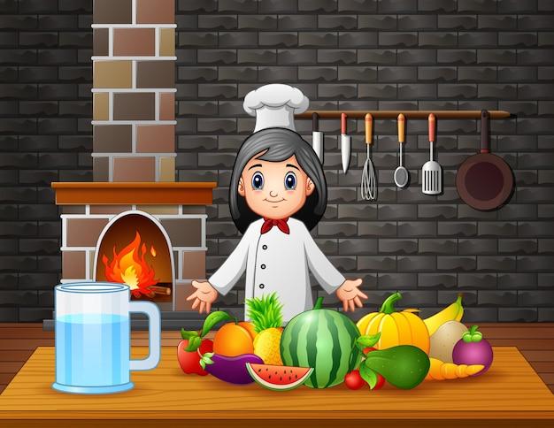 Una mujer chef mostrando un tipo diferente de frutas sobre la mesa