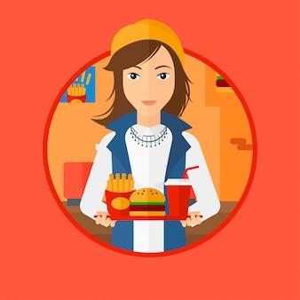 Mujer con comida rápida.