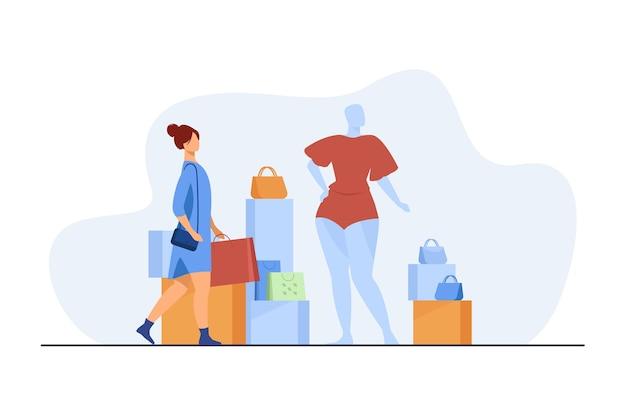 Mujer de compras en la tienda de moda. cliente con bolsas, maniquí, accesorio ilustración vectorial plana. consumismo, consumidor, concepto de compra de ropa.