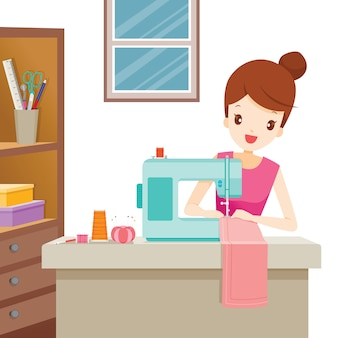 Mujer cosiendo ropa por máquina de coser
