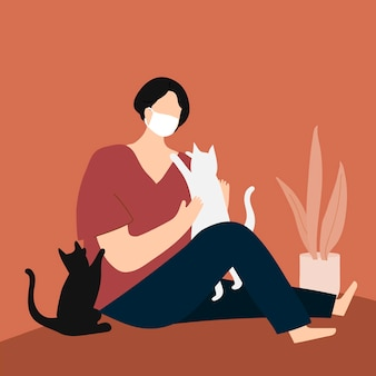 Mujer en cuarentena jugando con sus gatos