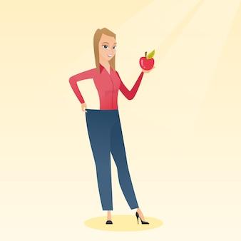 Mujer delgada en pantalones que muestra los resultados de su dieta.