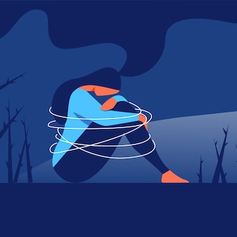 Mujer deprimida se sienta con el brazo envuelto alrededor de las rodillas