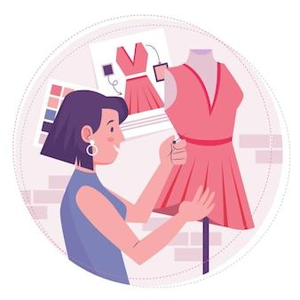 Mujer diseñadora de moda cosiendo un vestido