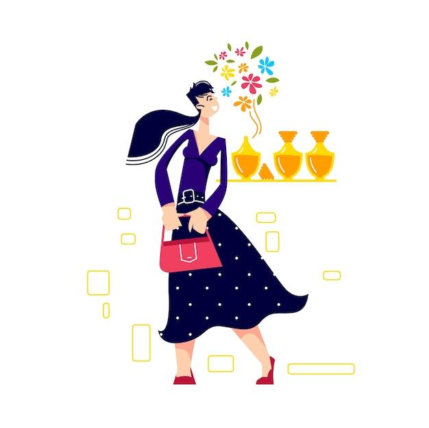 La mujer disfruta del aroma en la tienda de perfumería que huele a perfume de flores en la boutique de moda