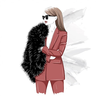 Mujer elegante en pieles y gafas