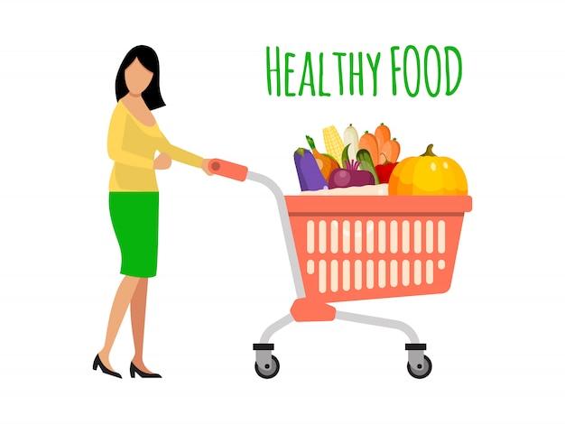 Mujer empujando un carrito lleno de frutas y verduras. chica con carrito de compras de alimentos saludables.