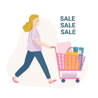 Mujer feliz con carrito de compras