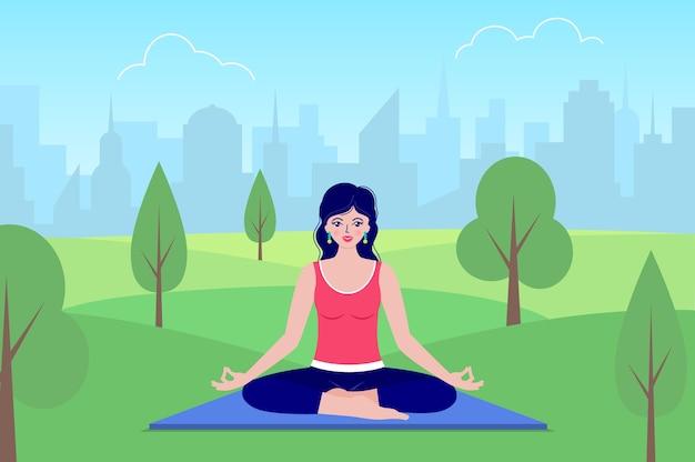 Mujer feliz medita sentado en la naturaleza. concepto de yoga.
