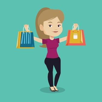 Mujer feliz que sostiene bolsos de compras.