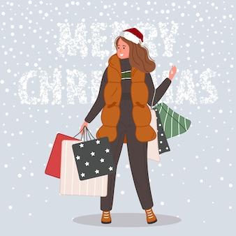 Mujer feliz con regalos de navidad y paquete mujer vistiendo gorro de papá noel sobre fondo de nieve
