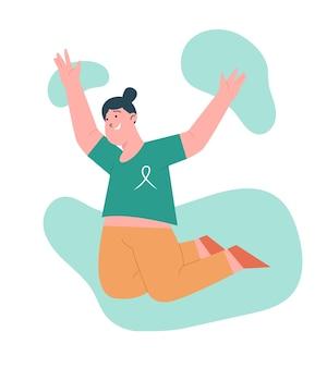 Mujer feliz saltando con cáncer de mama