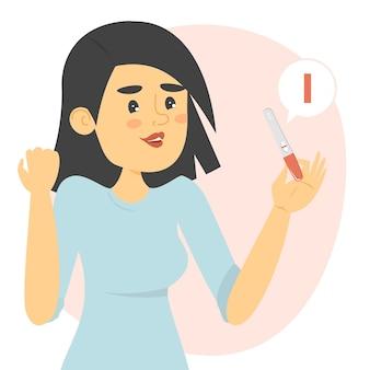 Mujer feliz sosteniendo una prueba de embarazo negativa