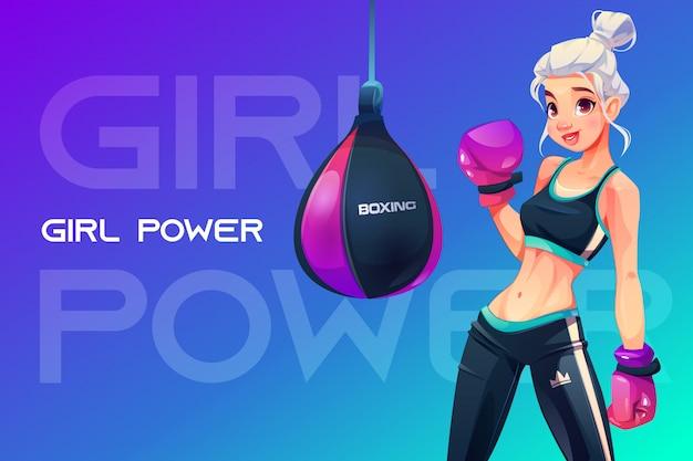 Mujer en guantes de boxeo posando en saco de boxeo