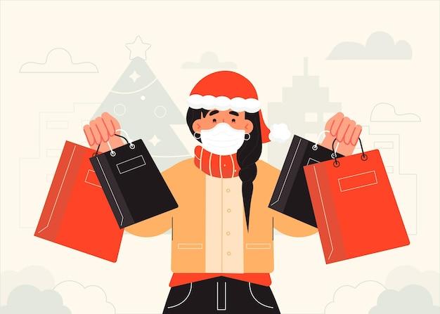 Mujer haciendo compras navideñas con máscara médica