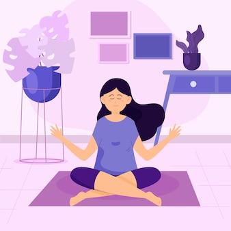 Mujer haciendo yoga en la alfombra