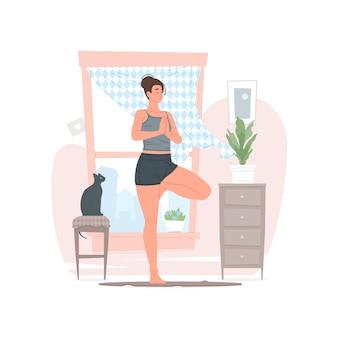 Mujer haciendo yoga en la mañana en casa