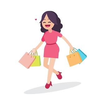 Mujer hermosa feliz caminando con bolsas de compras