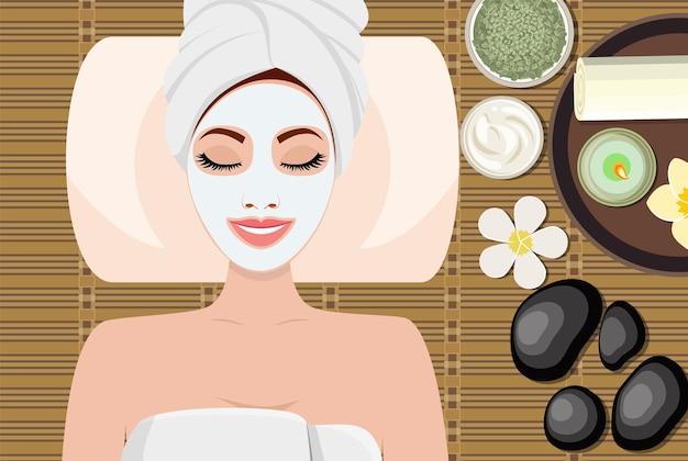 Mujer hermosa joven en spa. mujer recibiendo tratamiento de spa