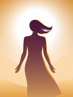 Mujer hermosa joven en un vestidorelaxing delante de un sol brillante