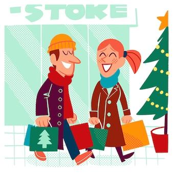 Mujer y hombre comprando regalos de navidad