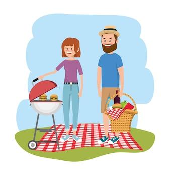 Mujer y hombre junto a parrilla y hambuergers.