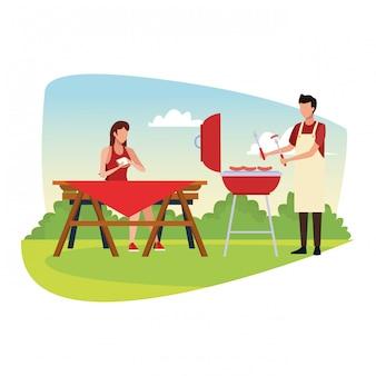 Mujer y hombre en un picnic y barbacoa