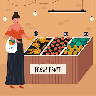 Mujer joven con cesta de la compra de alimentos en la tienda de comestibles