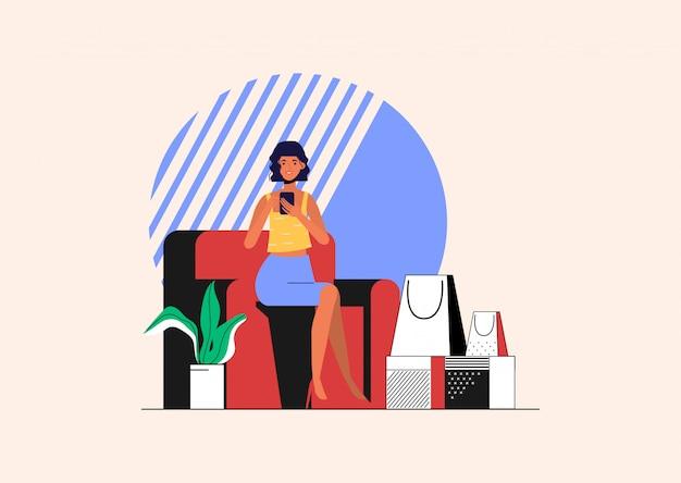 Mujer joven está comprando en línea y caja de entrega para el cliente