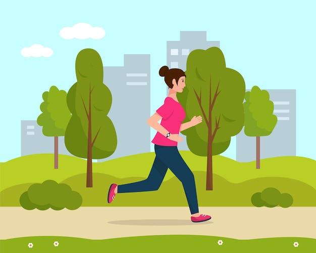 Mujer joven corriendo en el parque de la ciudad