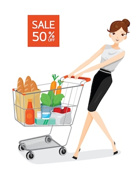 Mujer joven empujando el carrito de la compra lleno de alimentos, frutas y verduras
