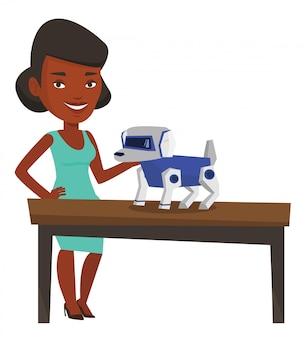 Mujer joven feliz jugando con perro robótico.