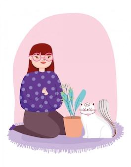 Mujer joven con gato blanco y planta en maceta