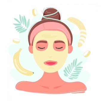 Mujer joven en máscara facial de plátano