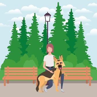 Mujer joven con mascota perro lindo en el parque
