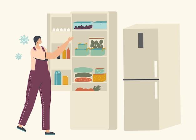 Mujer joven de pie cerca del refrigerador abierto con paquetes de verduras congeladas y recipientes con bayas heladas