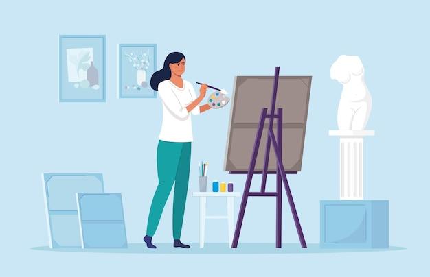 Mujer joven pinta con lienzo al óleo. artista aficionado de pie junto al caballete hermosa chica con paleta de pincel