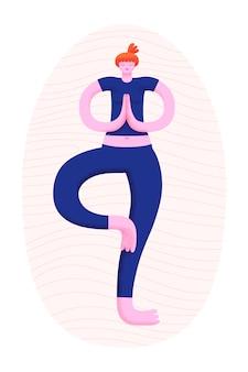 Mujer joven practicando yoga de pie en equilibrio sobre una pierna