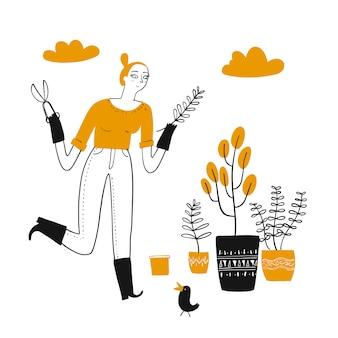 Mujer joven que tiene felicidad y jardinería en casa.