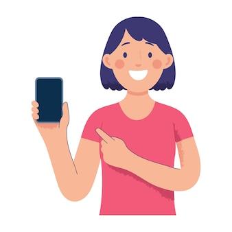 Una mujer joven sostiene un teléfono inteligente y lo señala con otro dedo